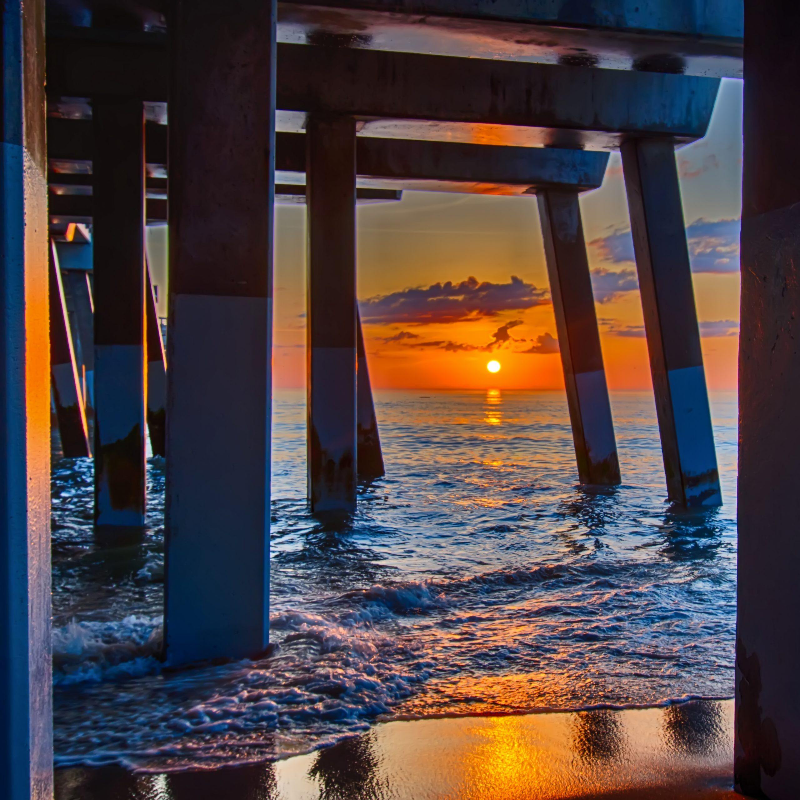 sunset under a pier